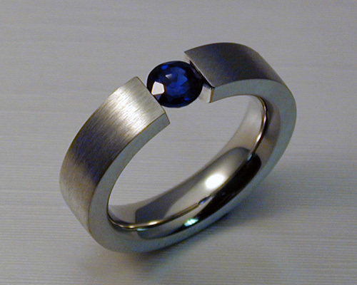 Tension Set Blue Sapphire Engagement Ring.
