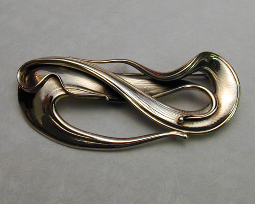Musical, fluid organic freeform brooch.