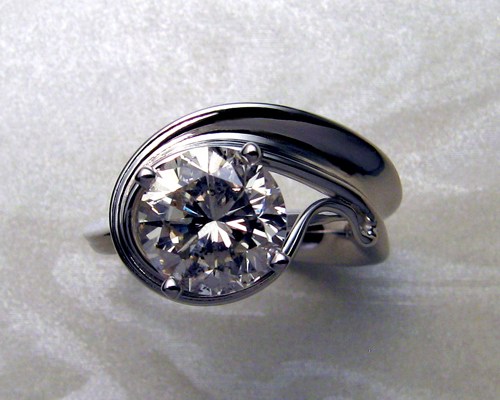 Unusual, asymmetrical engagement ring.