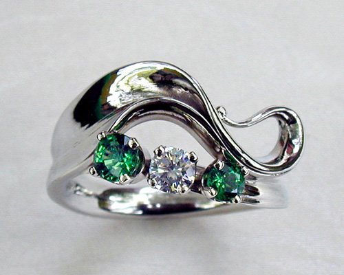 Wave-like free-form engagement ring.