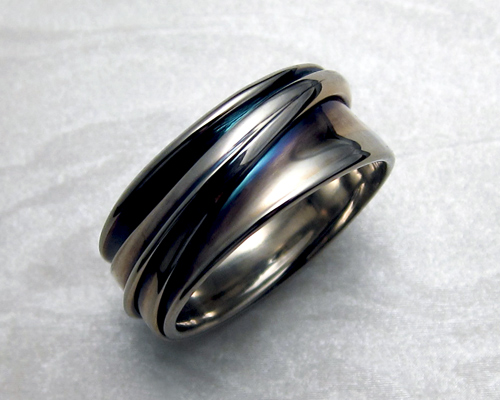 White gold band, continuous wrap with patina.