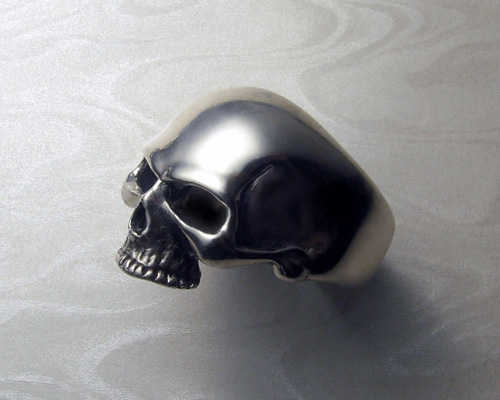 Large, heavy, skull ring.