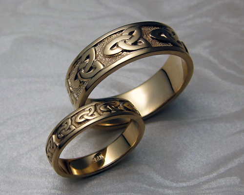 Matching Celtic bands, with  trinity knot-work.