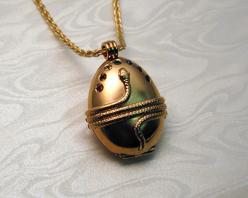 Cosmic, Orphic egg pendant.