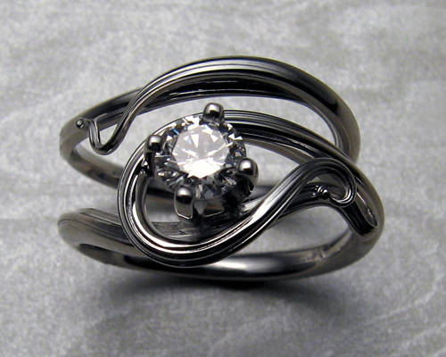 Free-form, art nouveau style engagement ring set.