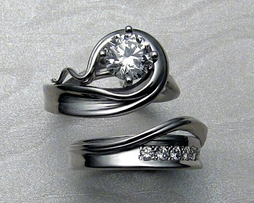 Unique engagement ring with matching band.