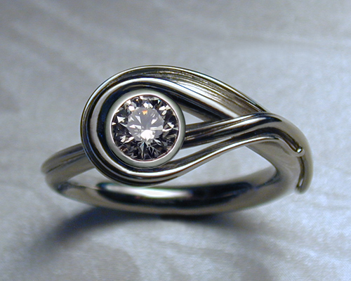 Engagement ring with bezel option.