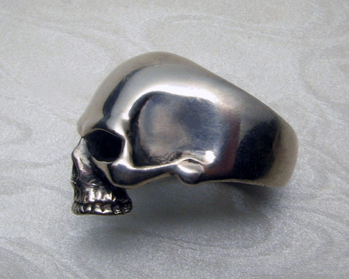 Large, heavy skull ring (profile view)