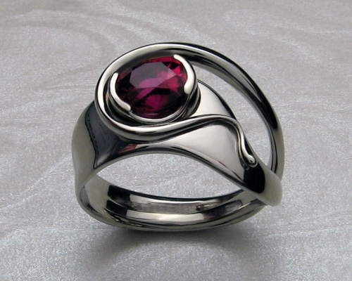 Organic free-form ring. Handcrafted in 14k white gold, with ruby set in split bezel setting.