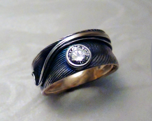Fingerprint band with bezel set 1/4ct diamond. 14k yellow gold with black patina. 8mm wide.