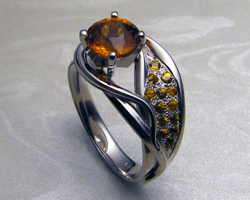 asymmetrical_engagement_ring_with_orange_sapphires_2.jpg