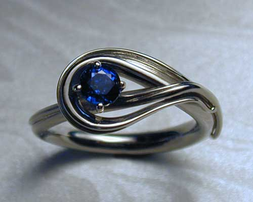 Fluid, freeform, sapphire engagement ring.