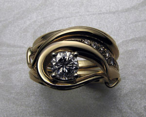 Fluid organic, free-form engagement ring set.