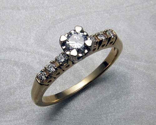 Heart engagement ring with 20 hearts.
