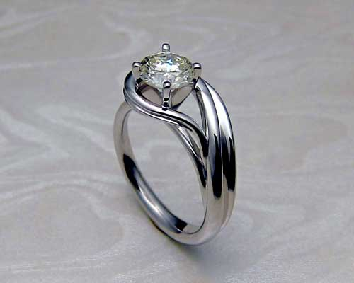Beautiful asymmetrical engagement ring.