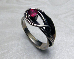 Art-nouveau style engagement ring with ruby.