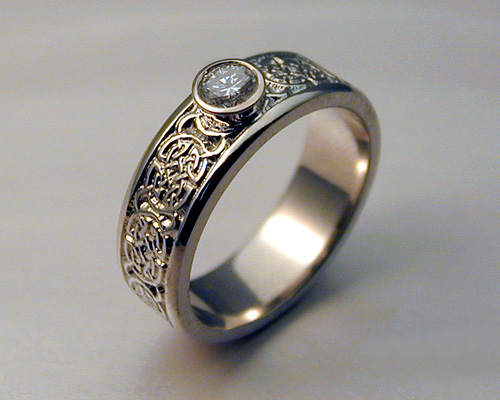 8th to 9th century Celtic wedding band with bezel set diamond.