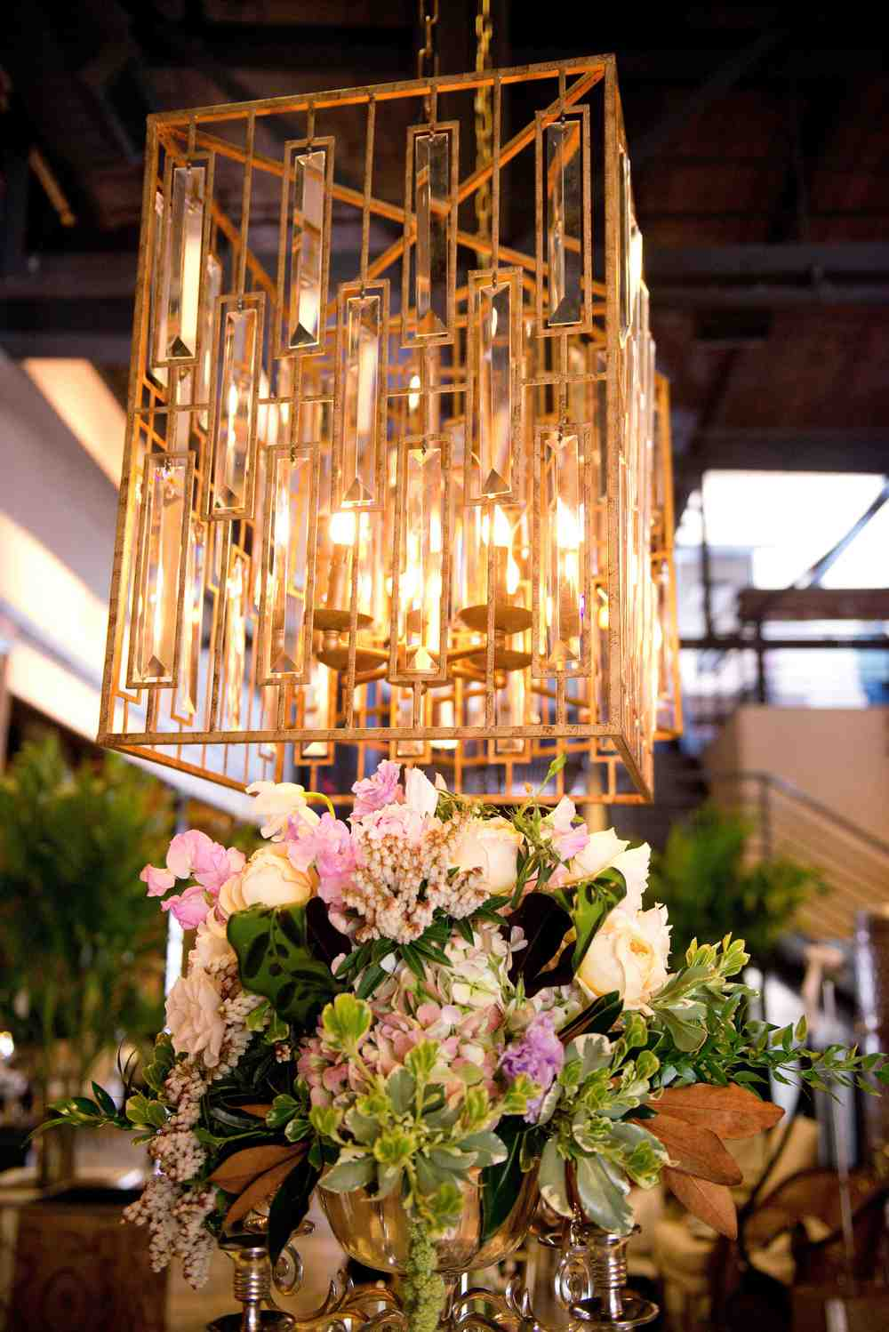 {Chandeliers were hung in the center of the distillery to anchor the dining table}