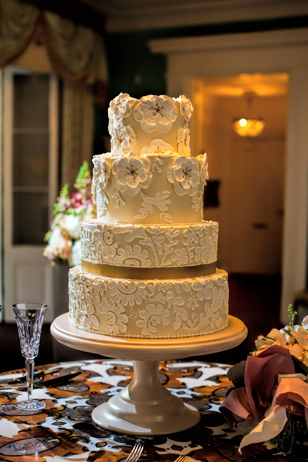 This wedding cake is actually from my wedding.  The amazingly talented  Jim Smeal  did this cake and hand did the lace to replicate my veil, which my Mom wore on her wedding day.  I've never seen such talent on a butter cream cake than his cakes!
