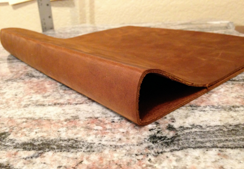 7 : The leather is cleaned up around the edges, marked with chalk to the correct size and hammered into shape.