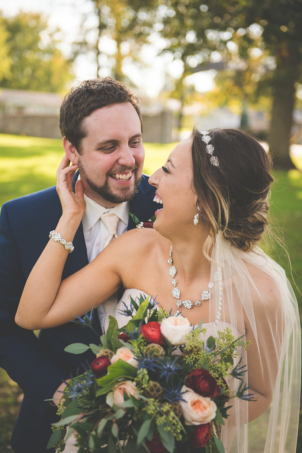 Cassandra and Derek enjoying a few laughs before their reception at the Mercer County Fairgrounds.