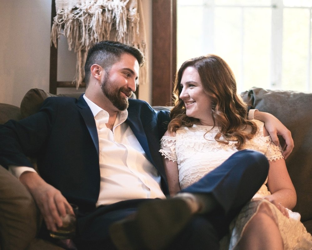 Cece & Alex' enjoying a drink in their Logan Square apartment before we continued their engagement session through the neighborhood.
