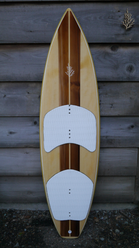 "Kite board in Port Orford cedar, Red cedar, Kevlar rails, Carbon/innegra heel patches under skins. High density inserts for fin boxes.  5'5"" x 17 3/8"" x 1 3/4"""