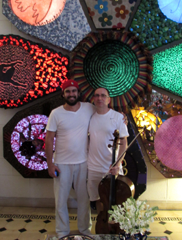 Udi with local artist, Lorenzo, in front of the artists' work