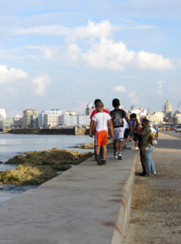 Children walking along la malecon