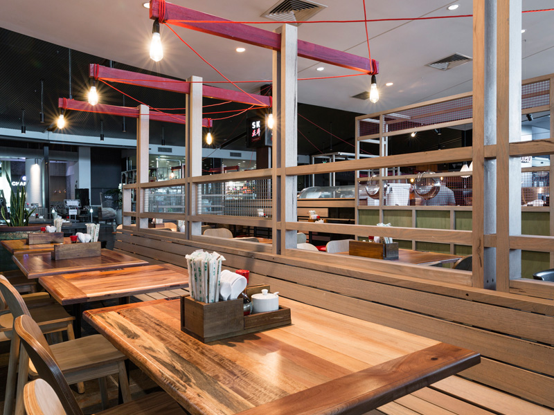 Secret Kitchen Doncaster. Timber bench seating brings structure to the space without blocking views.