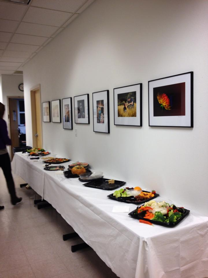 Student's work hanging on the wall at Colorado Mountain College during 2013 fall portfolio review. Each student is required to leave a framed and matted image behind to hang in the school for all time.