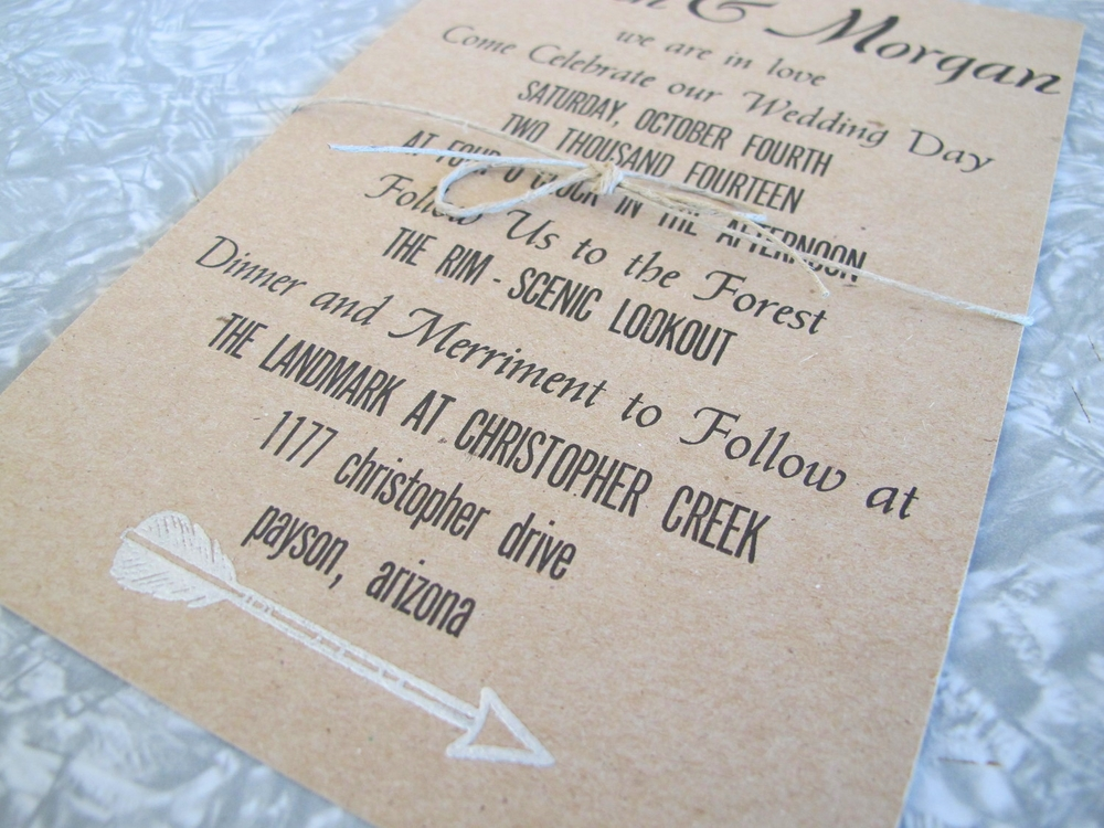 Letterpressed wedding invitation on chipboard, wrapped in twine.  Hand embossed arrow.