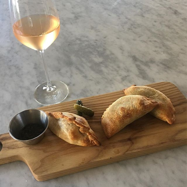 You can be having Empanadas and wine right now!  One of our favorites is back on the menu—swiss chard, brie, sage & leeks.  #ojai #patio #winebar
