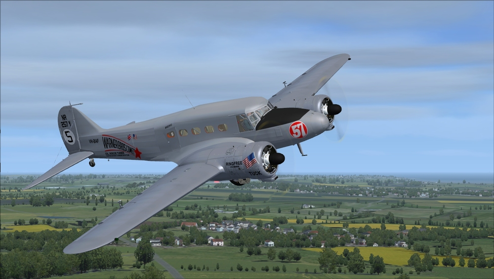 This is a civil Mk.1, with passenger interior, covered upper canopy, smooth engine cowls and civilian pilots.