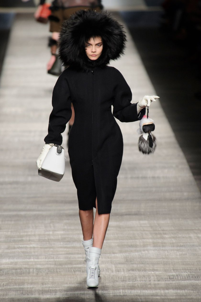 Cara Delevingne carrying Karlito down the runway, which retails at $1,650.