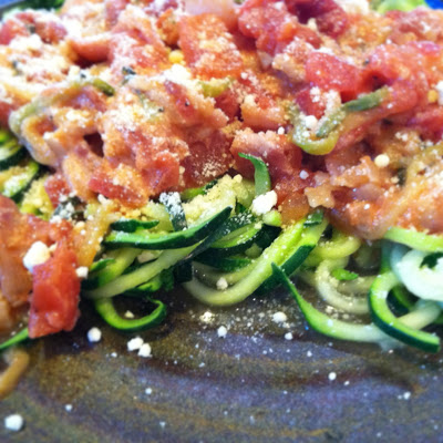 "Zucchini ""pasta"" with a simple summer red sauce (tomatoes, sweet onion and basil)"