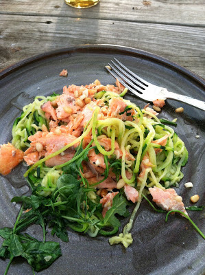 "Pan-seared salmon, wilted arugula, garlic and pine nut zucchini ""pasta"""