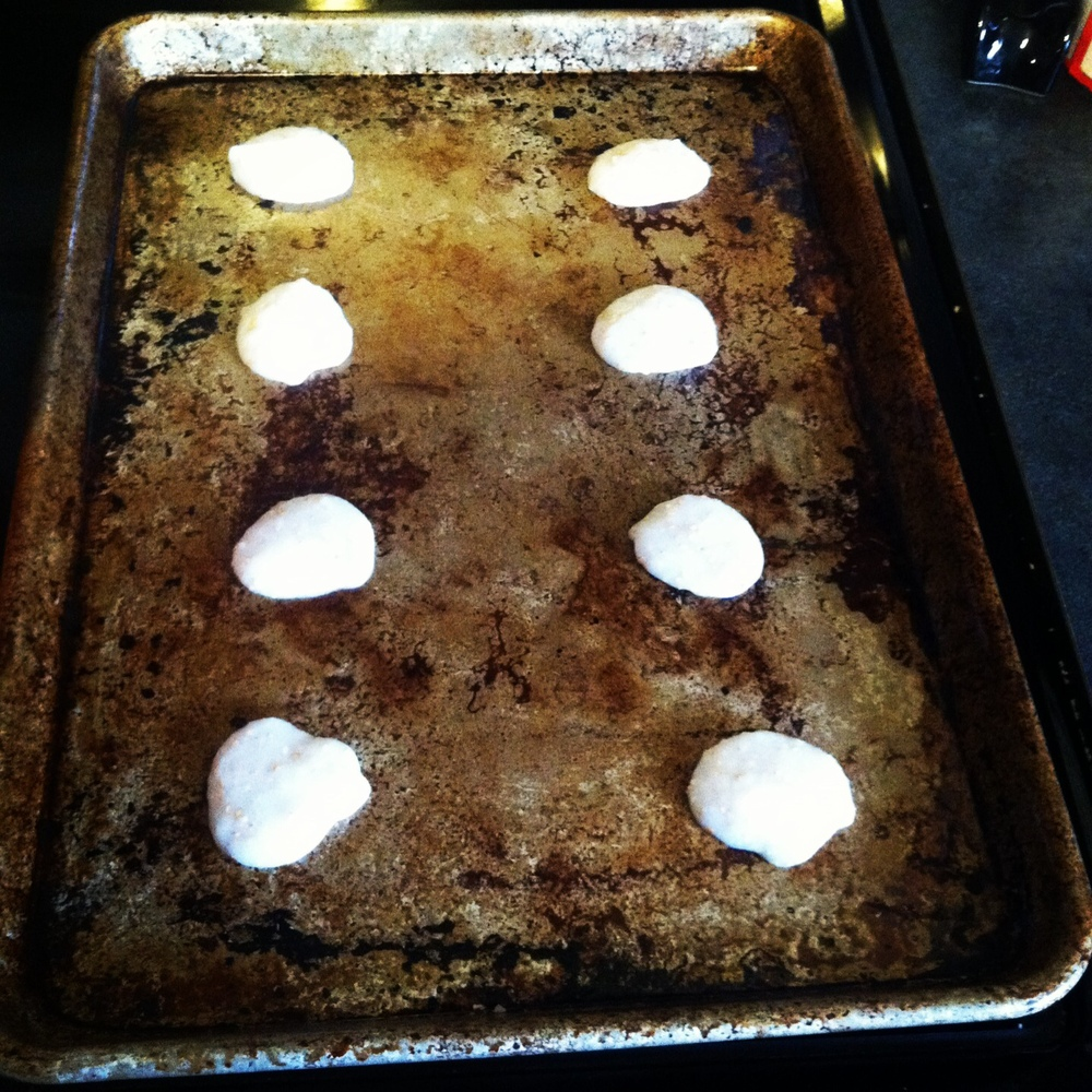Spooning the cracker mixture onto my well-used sheet pan.