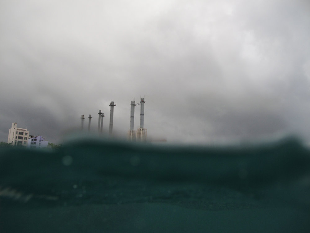 The STELCO towers from the water on a stormy day.