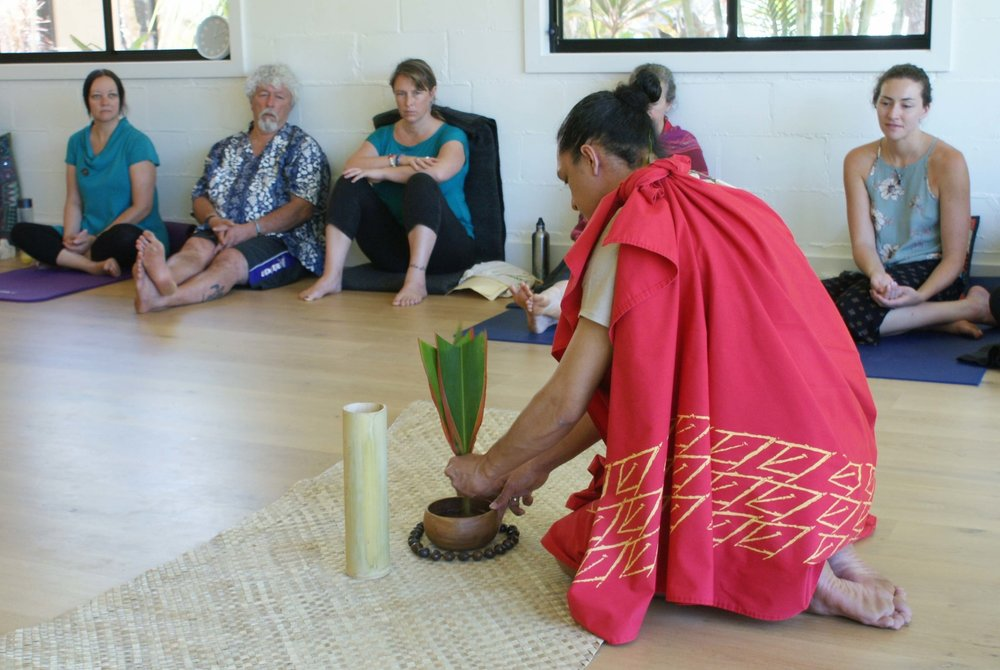 Kumu Paʻa Kawika Foster of Mana O Kahiko preparing for a ceremony