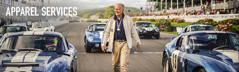 Wearing the Racing Division Shelby Team Jacket reissue, Peter Brock walks amongst his Cobra Daytona Coupes, gathered at the 2015 Goodwood Revival. Photo: Nigel Harniman