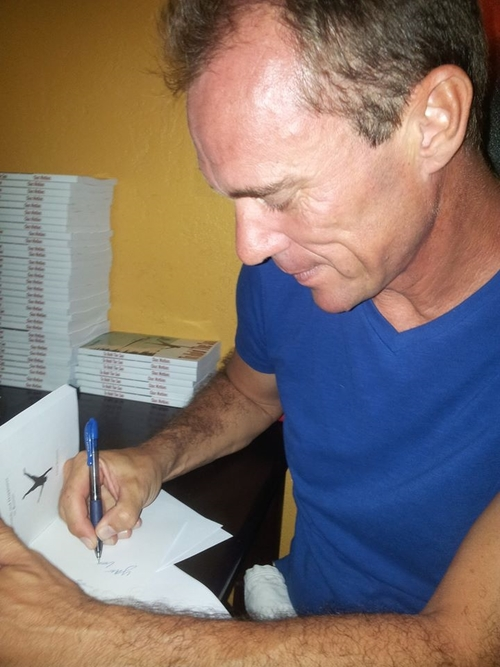 Chas watkins at a book signing on roatan