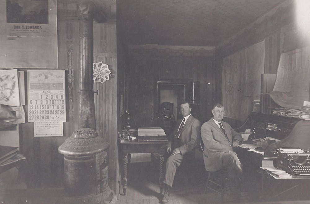 E. H. Elliott and F. E. Murphy  -  Officers of The Santa Fe Bank at Santa Fe, Kansas.  Safe back in the vault-presently in use at the bank in Sublette.  Calendar on the wall is June 1915