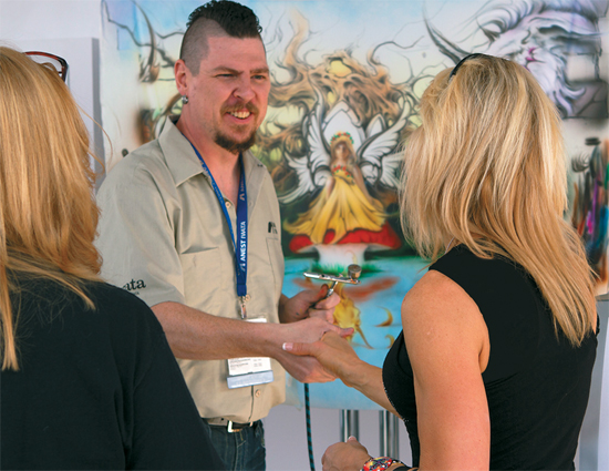 Airbrush artists participating in American Express Open's Rising Stars of SEMA took time away from the competition to interact with attendees and answer questions.