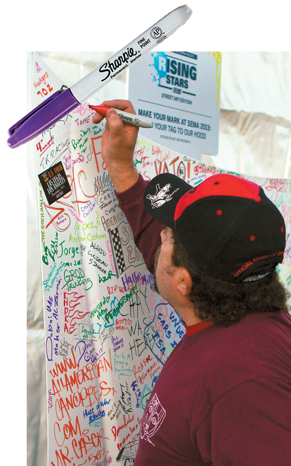 """SEMA attendees got in on the action by """"tagging"""" four """"graffiti hoods"""" with colored Sharpies."""