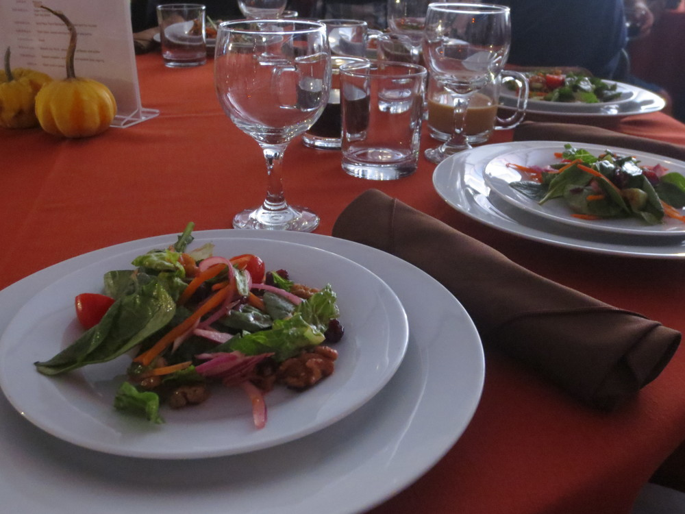 A Cranberry -Walnut salad with Raspberry Vinaigrette began the people's dinner celebration.