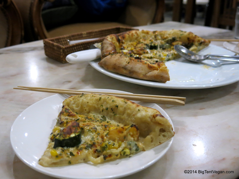 Vegan White Pizza with Grilled Squash and Roasted Potatoes from Vegans        12.00       Café and Restaurant (100% vegan restaurant and grocery store) in Kyoto, Japan. I don't know why we have chopsticks and spoons in this pic...we ate this pizza with our hands as pizza should be eaten!