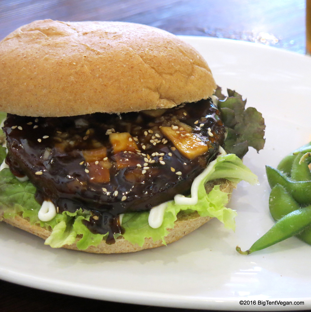 Grilled Meatless Teriyaki Burger with Ginger Teriyaki Sauce, Minced Onion, Eryngii Mushroom Slices, Red Leaf Lettuce, Vegenaise, and Sesame Seeds...so GOOD!