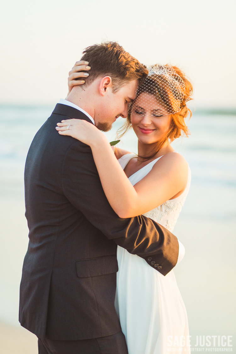 4S0A8690- bride and groom in carlsbad pelican point .jpg