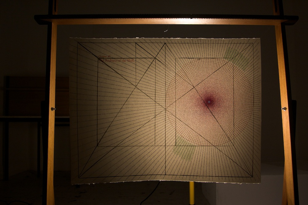 Chapter 42: the redness of the shift. Lithograph, solvent transfer and light on paper, hanging in tapestry loom. Text from Moby Dick and Einstein's General Theory of Relativity. 2010.